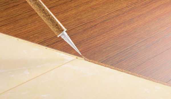 Заделка стыка между плиткой и ламинатом